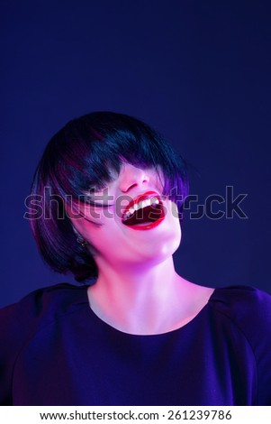 happy mood actress. studio on dark - stock photo
