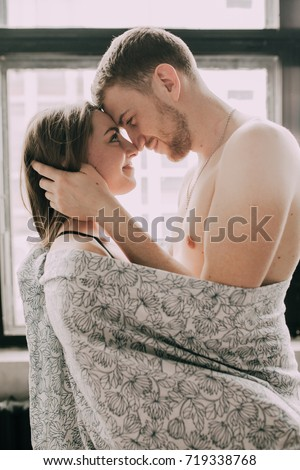 Happy Morning Of Young Romantic Couple In Love Have Fun Kissing And Hugs Bedroom