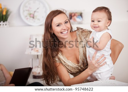 happy mother and adorable baby - stock photo
