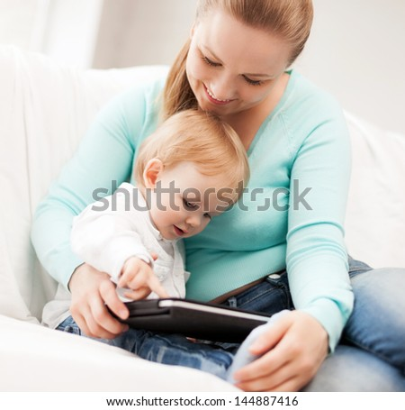 happy mother and adorable baby with tablet pc - stock photo