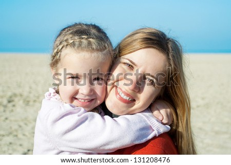 happy mother and adorable little girl - stock photo