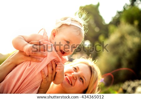 Happy mother and baby girl - stock photo