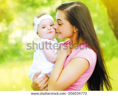 Happy mother and child in the summer sunny day - stock photo