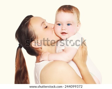 Happy mother and cute baby in happiness - stock photo