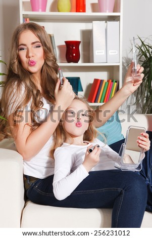 Happy mother and daughter at home - stock photo
