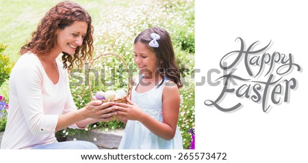 Happy mother and daughter collecting easter eggs against happy easter - stock photo