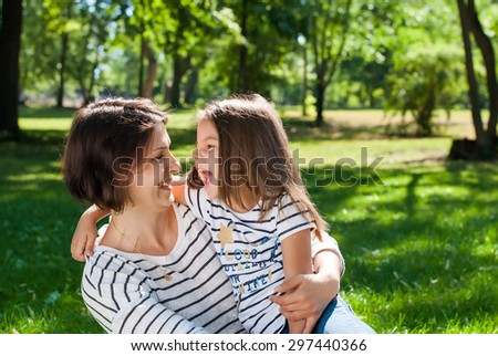 Happy Mother and Daughter have Fun in Sunny Day on Meadow - stock photo