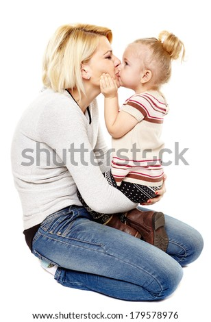 Happy mother and daughter kissing, isolated on white background