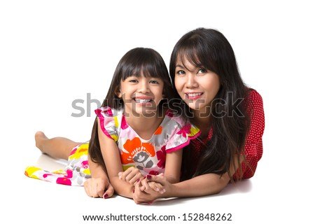 Happy mother and daughter laying on the floor, Isolated over white - stock photo
