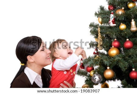 happy mother and daughter over christmas tree