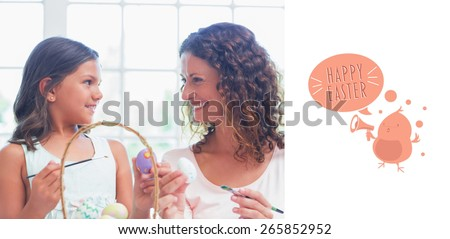 Happy mother and daughter painting easter eggs against happy easter graphic - stock photo