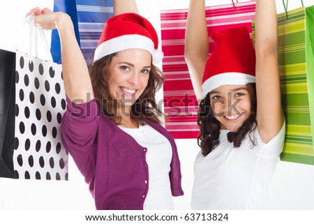 happy mother and daughter with Christmas shopping bags - stock photo