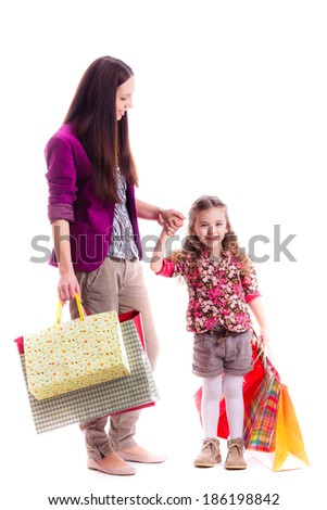 happy mother and daughter with shopping bags, isolated on white background