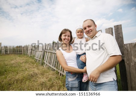 happy mother and father with child - stock photo