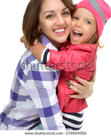 Happy mother and four years old daughter laughing together hugging smiling isolated on a white background - stock photo