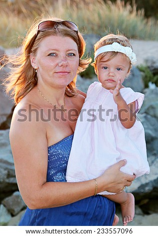 Happy mother and her baby daughter in the park - stock photo
