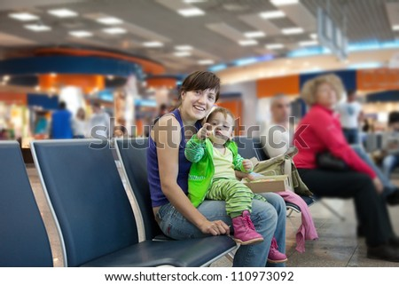 Happy mother and her child at airport - stock photo