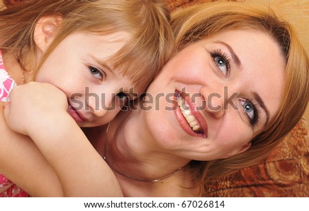 Happy mother and her little daughter at their home