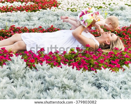 Happy mother and her little daughter in the summer park - stock photo