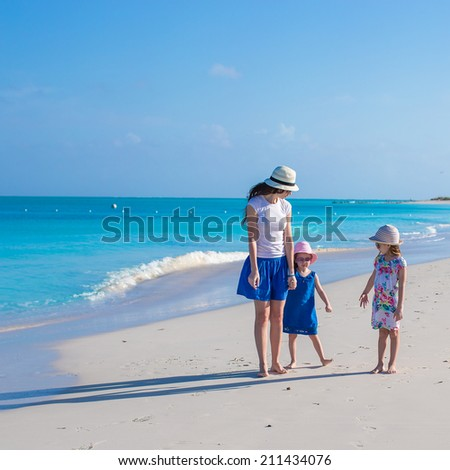 Happy mother and her little girls enjoy summer vacation