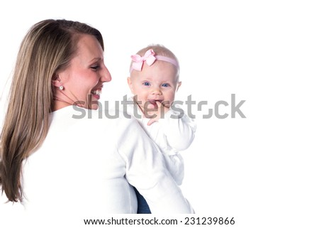 Happy mother and her six-month daughter - stock photo