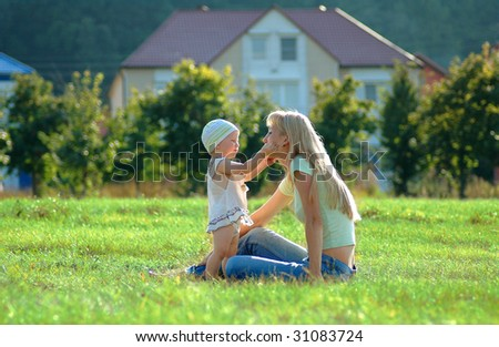 Happy mother and little child - stock photo