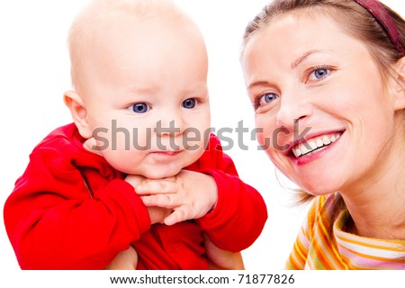 Happy mother and lovely baby in red - stock photo