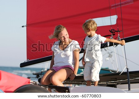 happy mother and son on sea yacht background