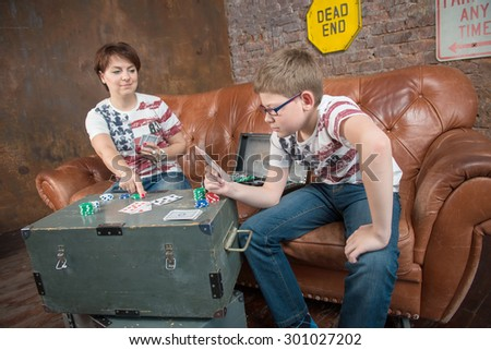 Happy mother and son playing in an entertaining game at home - leisure, games and lifestyle concept - stock photo