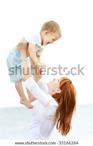happy mother and son playing outdoors - stock photo