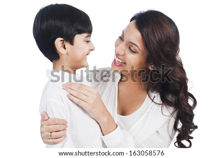Happy mother and son smiling - stock photo