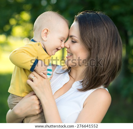 Happy mother and son together playing nose - stock photo
