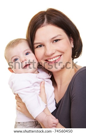 Happy mother carrying her baby girl in her hands - stock photo