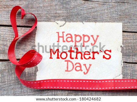 Happy mother day on aged paper on wooden background - stock photo