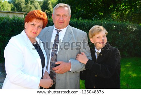 Happy  mother, father and their son outdoor in summer park - stock photo