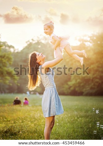 Happy mother having fun with her daughter