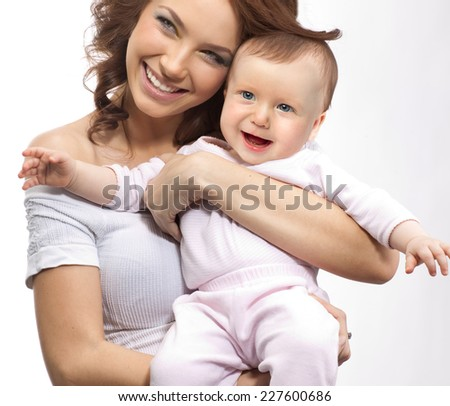 happy mother holding baby smiling studio shot isolated on white - stock photo