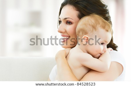 happy mother holding her baby - stock photo