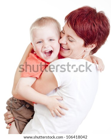 happy mother holding her little son smiling