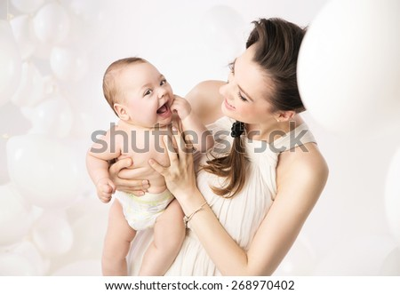 Happy mother holding her newborn baby - stock photo