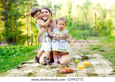 happy mother hugging her 2 children: son and daughter - stock photo