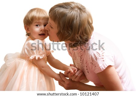 Happy mother kissing baby in formal dress