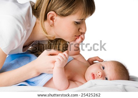 happy mother kissing her little child's hand - stock photo