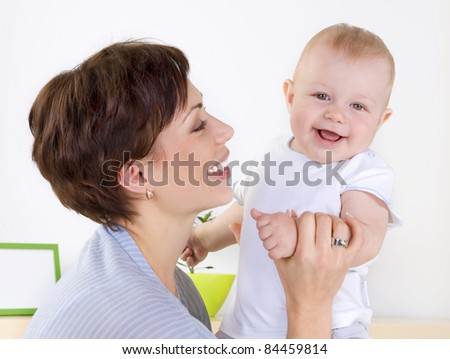 Happy Mother playing with her Baby - stock photo
