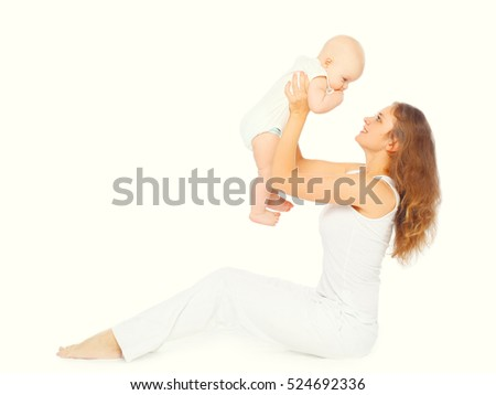 Happy mother playing with her baby on a white background