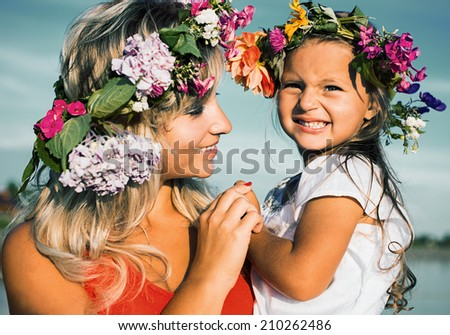 Happy mother playing with her child - stock photo