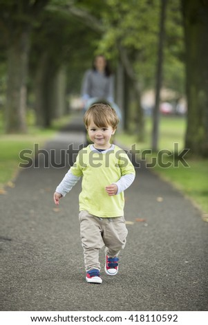 Happy Mother playing with her toddler son outdoors. Love and togetherness concept. selective focus - stock photo