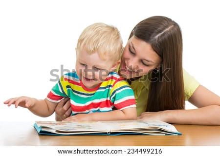 happy mother reading a book to child son