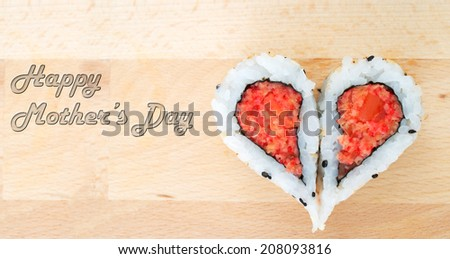 Happy Mother's Day concept with sushis forming a heartp shape on wooden cutting board - stock photo