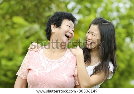 Happy mother talking with her daughter. - stock photo